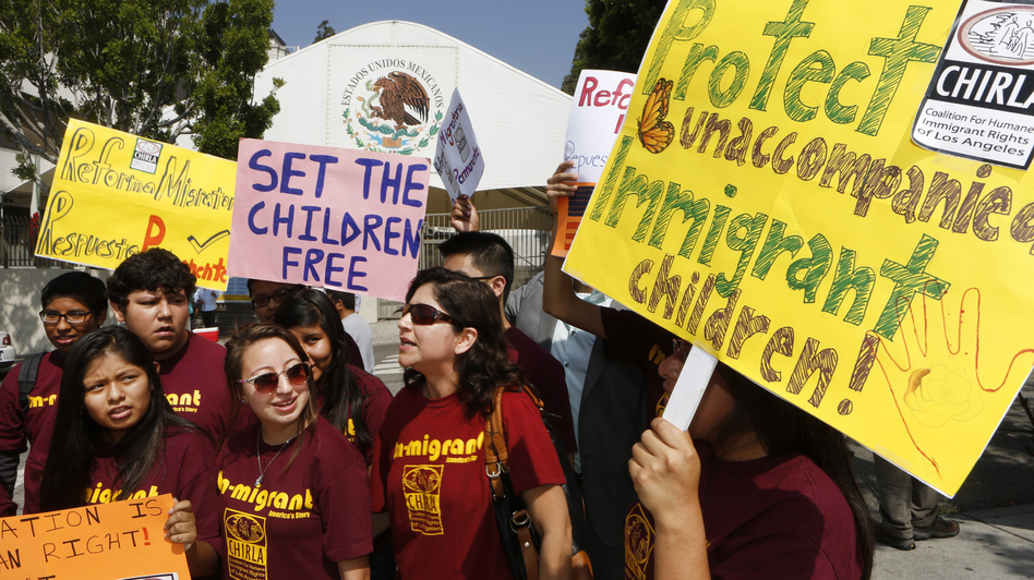 The U.N. is encouraging the U.S., Mexico, and other countries to treat migrant children as refugees, on the grounds that they're fleeing danger. Last week, immigration activists demanded that Mexico protect the rights of minors and families crossing its territory, during a protest outside the Mexican consulate in Los Angeles. Damian Dovarganes/AP