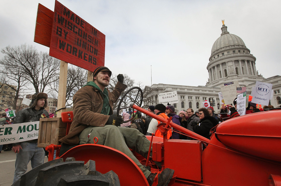 A farmer drives his tractor past the Wisconsin State Capitol during a rally in March of 2011. Scott Olson/Getty Images