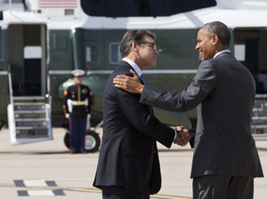 President Obama and Texas Gov. Rick Perry meet in Dallas on Wednesday. They later attended a meeting about the border and immigration together. Jacquelyn Martin/AP