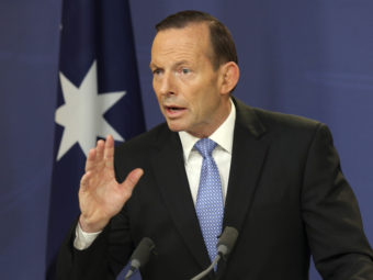 Australian Prime Minister Tony Abbott speaks during a news conference in Sydney last week. Abbott has announced the deployment of 190 police to help secure the MH17 wreckage site, where 37 Australians were killed. Rob Griffith/AP