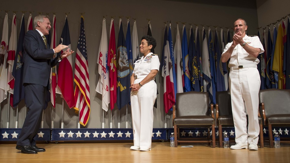 Secretary of the Navy Ray Mabus and Chief of Naval Operations Adm. Jonathan Greenert applaud Adm. Michelle Howard on her promotion Tuesday. MCC Peter D. Lawlor/U.S. Navy