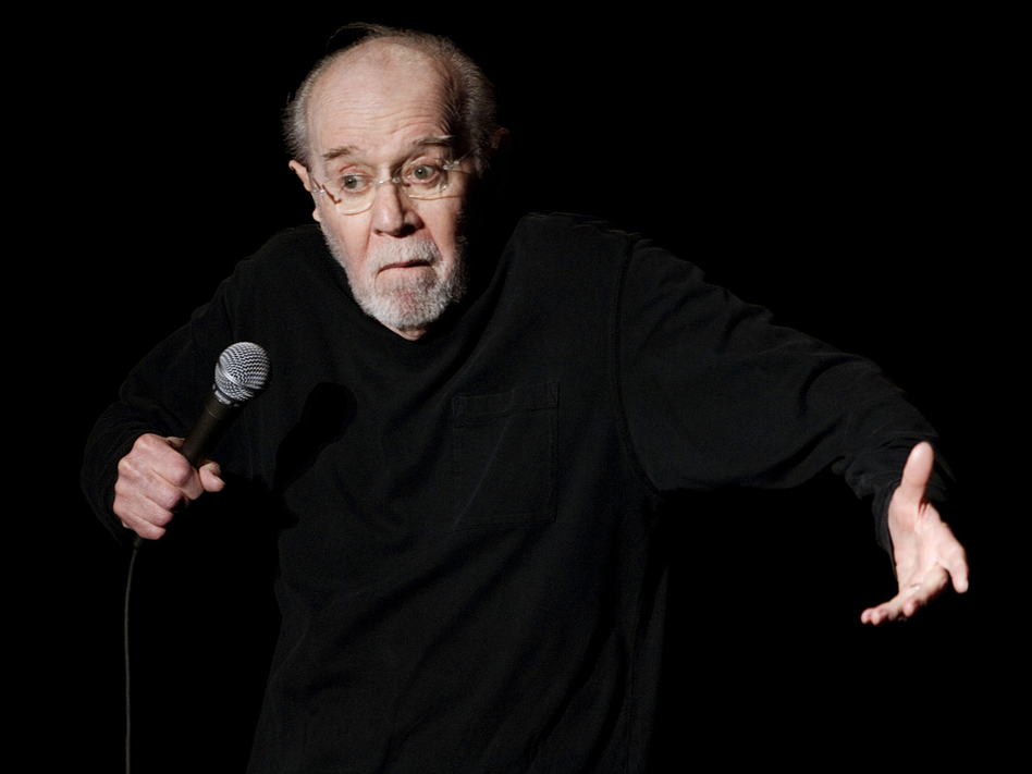 George Carlin opens the 13th annual U.S. Comedy Arts Festival at the Wheeler Opera House in Aspen, Colo., in 2007, a year before his death at age 71. E. Pablo Kosmicki/AP