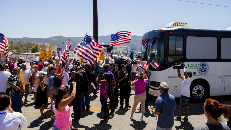 Protesters block the arrival of immigrant detainees who were scheduled to be processed at the Murrieta Border Patrol station in California on Tuesday. Sam Hodgson/Reuters/Landov
