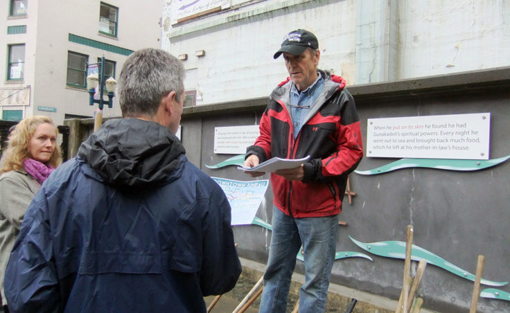 Bruce Denton hands out information to volunteers. (Photo by Rosemarie Alexander/KTOO)