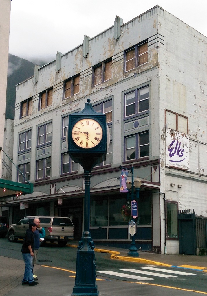 The burned out Gastineau Apartments frame Juneau's historical Front Street clock. (Photo by Rosemarie Alexander/KTOO)