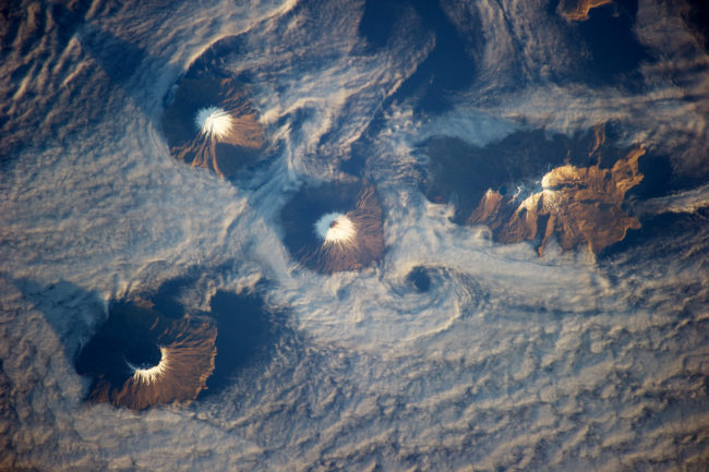 The Islands of the Four Mountains as seen from the International Space Station in 2013. Cleveland Volcano is at center. (Photo courtesy NASA)