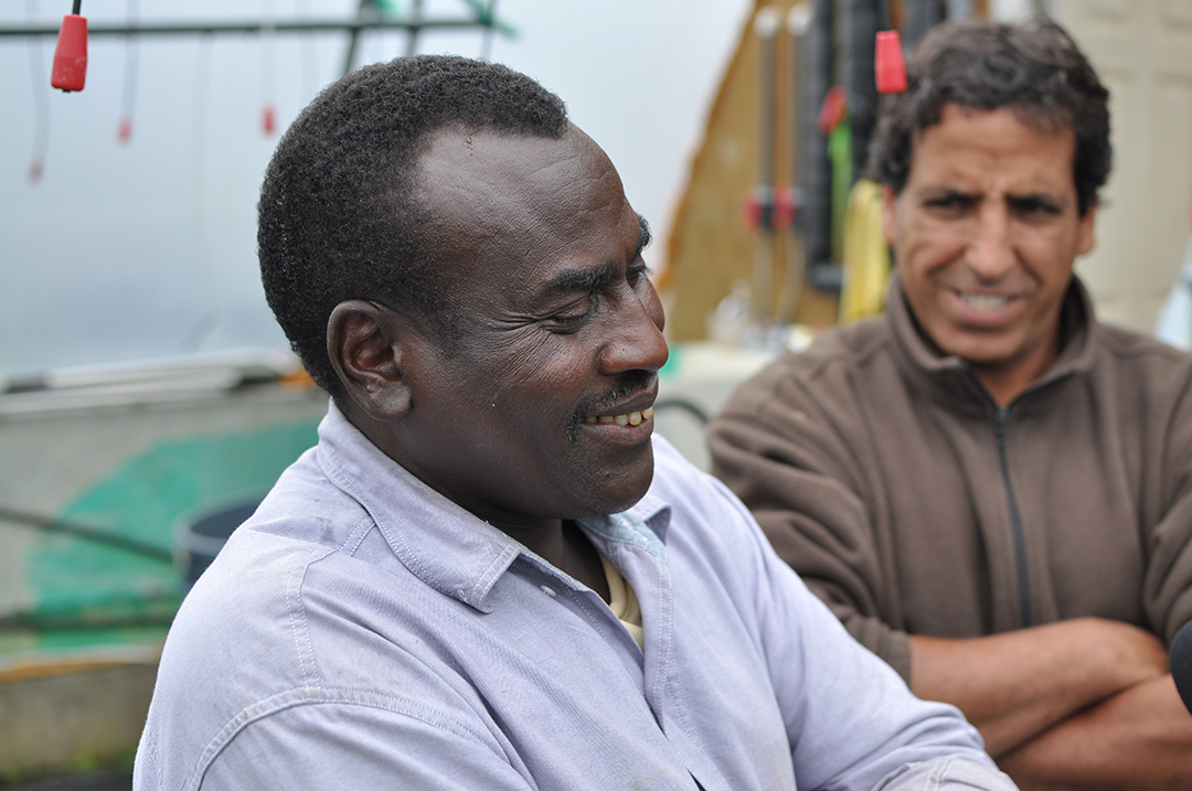 Issa Ali Abdul with his friend and translator. (Photo by Anne Hillman/KSKA)