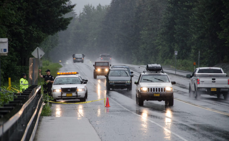 The Juneau Police Department placed officers at each end of the bridge on Back Loop Road to keep people from gathering on the bridge during heavy traffic. (Photo by Heather Bryant/KTOO)