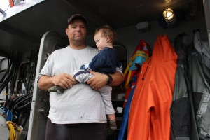 Joe Cisney and his son on a purse seiner. (Photo by Elizabeth Jenkins/KFSK)
