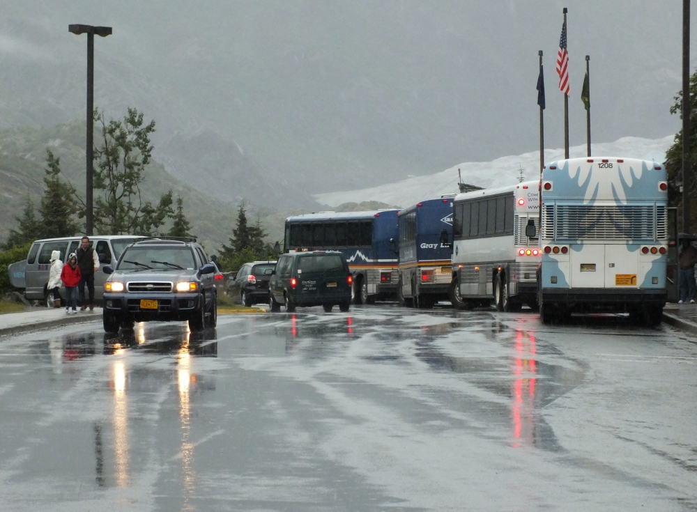 Buses at the Mendenhall Glacier Visitor Center. (Photo by Matt Miller/KTOO)