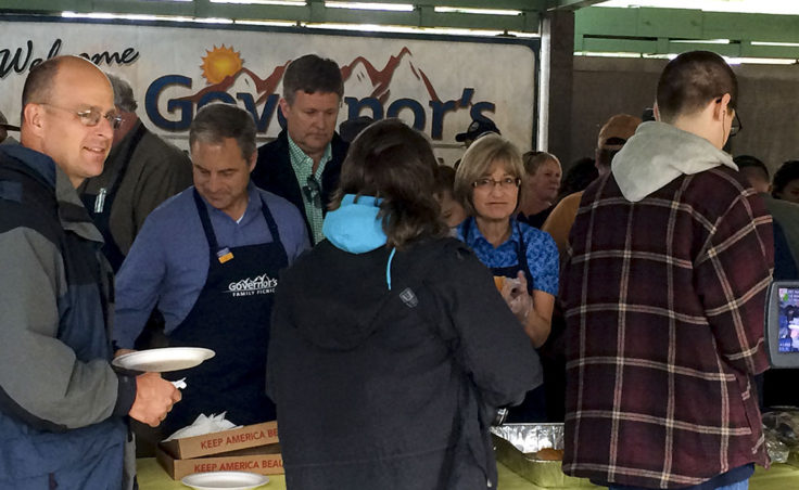 Gov. Sean Parnell and Sandy Parnell serve food to Juneau residents. (Photo by Sarah Yu/KTOO)