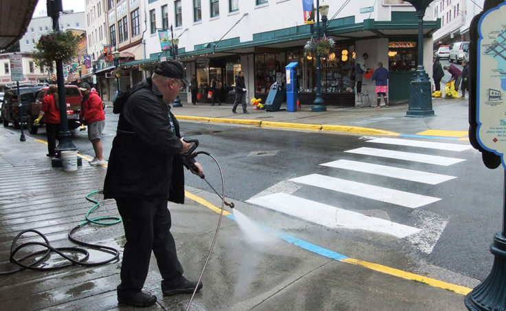 The effort included power washing the sidewalks and gutters. (Photo by Rosemarie Alexander)