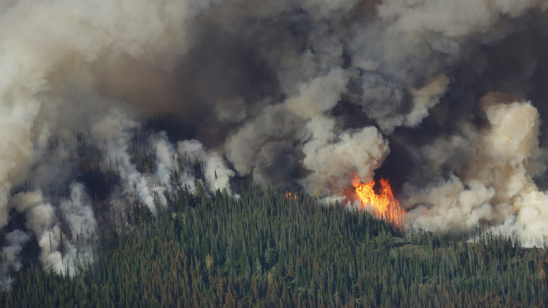 Smoke and flames rise from the Chiwaukum Creek Fire near Leavenworth, Wash., Thursday in this aerial photo. Ted S. Warren/AP