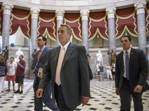 Speaker John Boehner makes his way to the House chamber on Wednesday. J. Scott Applewhite/AP