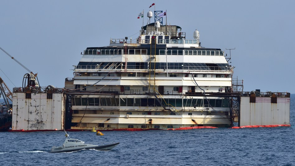 The process of refloating the Costa Concordia cruise ship started off Italy's Giglio Island Tuesday. Guiseppe Cacace/AFP/Getty Images