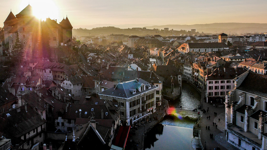 The sun sets behind the buildings of the old city of Annency, France. drone-cs/Dronestagram
