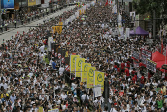 Tens of thousands of people march Tuesday in downtown Hong Kong during an annual protest pushing for greater autonomy. Vincent Yu/AP
