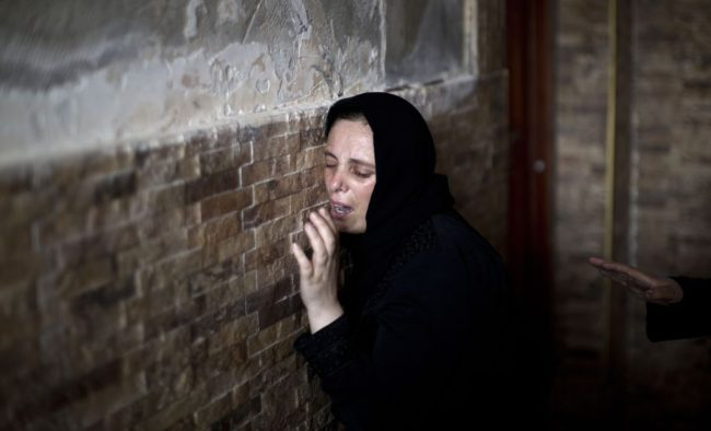 The Palestinian sister of Mohammed al-Daeri, 25, mourns during his funeral in Gaza City on Thursday. Mahmud Hams /AFP/Getty Images