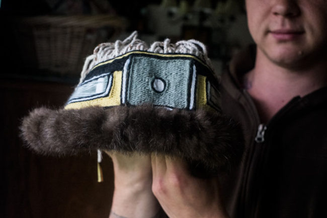 A man holds a Chilkat head band