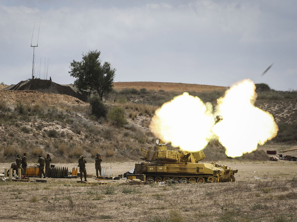 An Israeli artillery shell is fired at the border with Gaza on Friday near Sderot, Israel. Late last night Israeli forces escalated their operation with a ground offensive, sending troops into Gaza. More than 250 Palestinians have lost their lives since Israel began operation 'Protective Edge'. Ilia Yefimovich/Getty Images