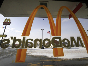 The National Labor Relations Board says McDonald's shares responsibility for how workers are treated at its franchised restaurants. Gene J. Puskar/AP