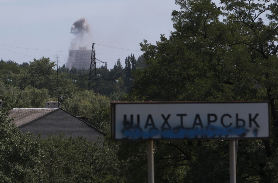 Smoke from shelling rises over a residential apartment house in Shakhtarsk, which is in the Donetsk region of Ukraine, on Monday. Dmitry Lovetsky/AP