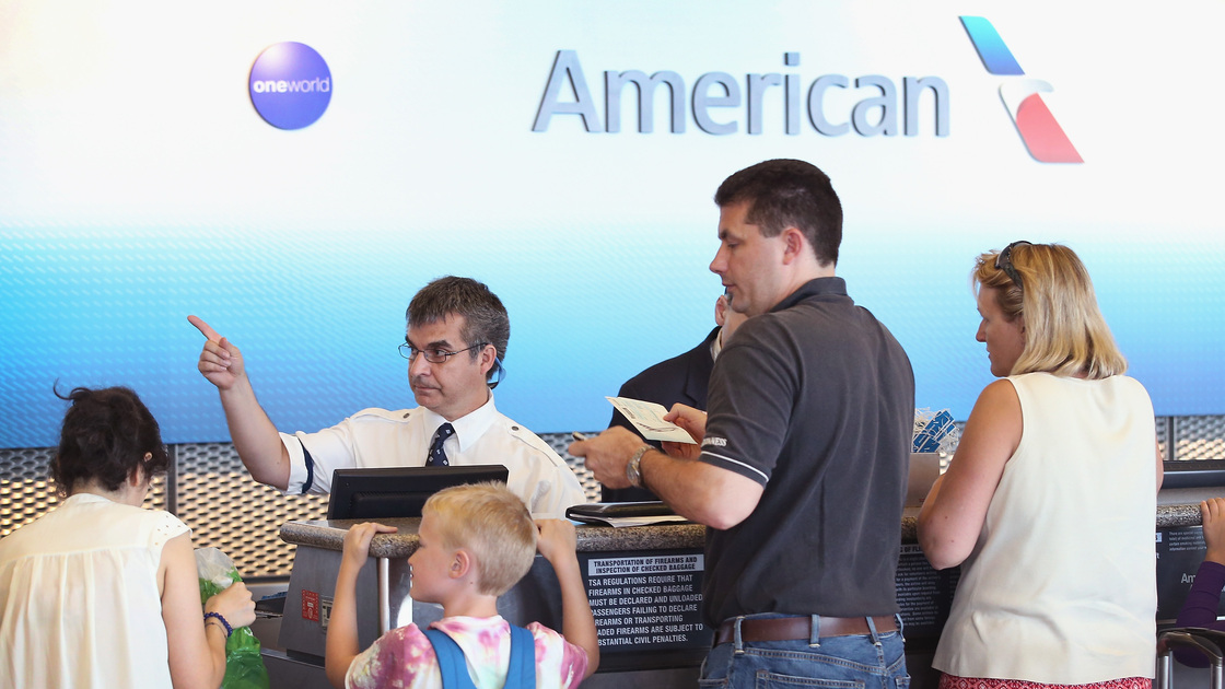 A family checks in for an American Airlines flight at Chicago's O'Hare International Airport. Scott Olson/Getty Images