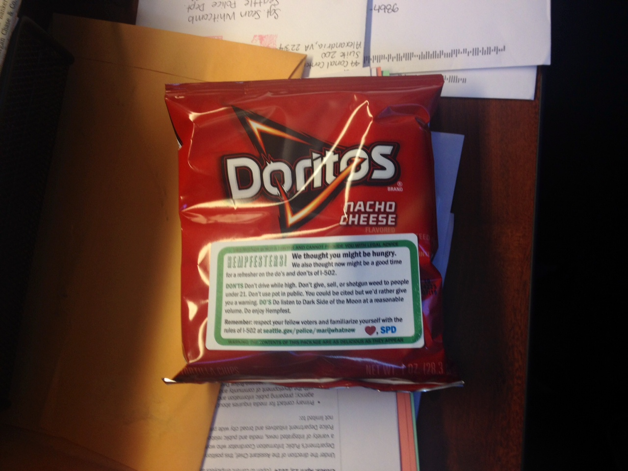 Seattle PD handed out these chips at Hempfest with stickers reminding users of the rules. (Alexandra Gutierrez/APRN)