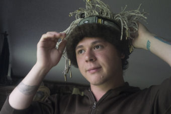 A man wears a Chilkat headband