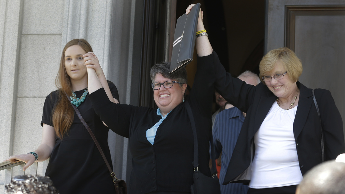 Plantiffs in the suit over Virginia's ban on gay marriage, Emily Schall-Townley (from left), Carol Schall and Mary Townley, after a hearing on May 13. Steve Helber/AP