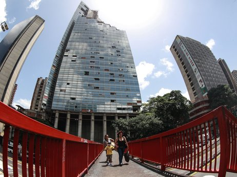 Squatters living at the Tower of David, an abandoned, unfinished skyscraper in Caracas, began to be evicted and relocated Tuesday. Federico Parra/AFP/Getty Images