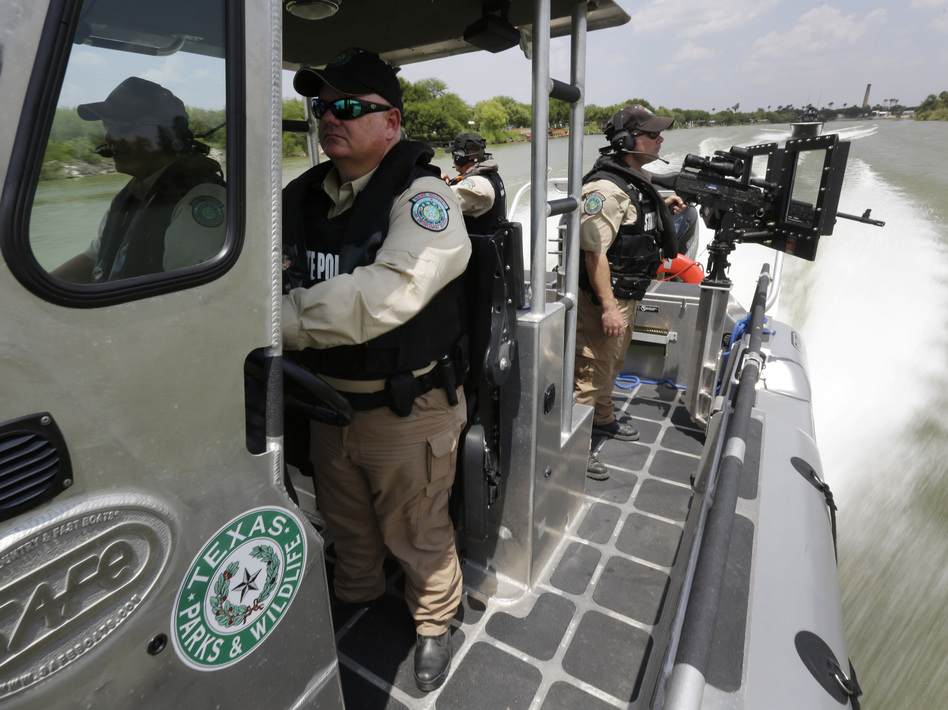 Texas Parks and Wildlife wardens patrol the Rio Grande on the U.S.-Mexico border in Mission, Texas, earlier this month. Eric Gay/AP