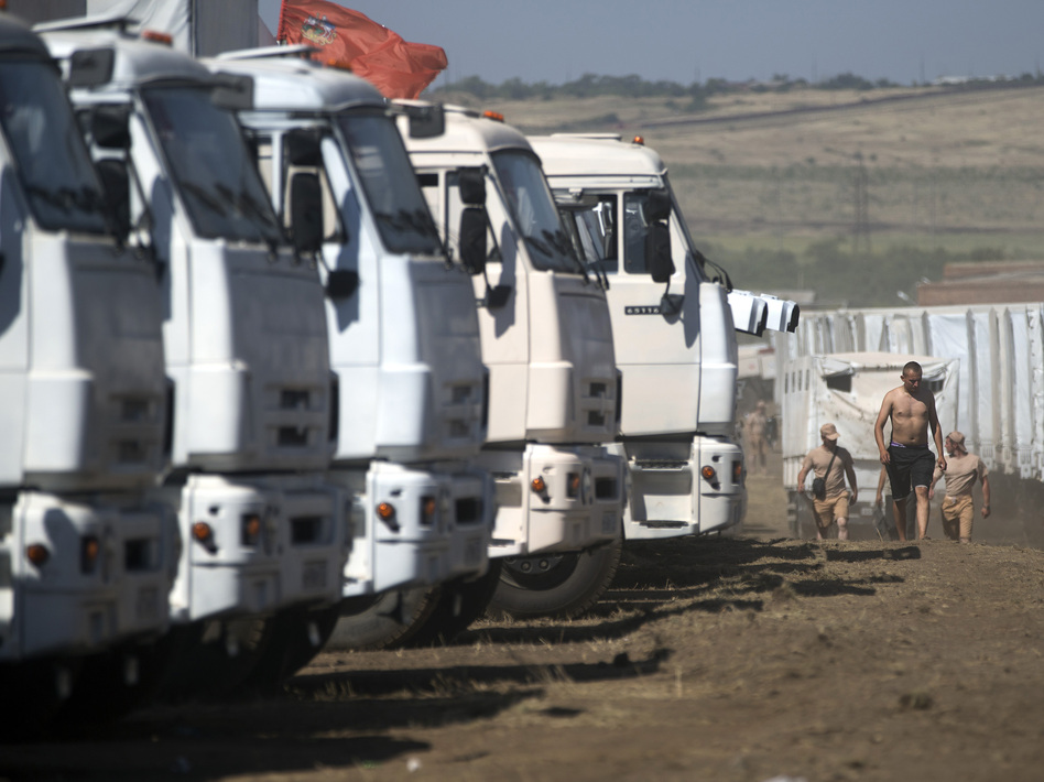 A convoy purportedly carrying humanitarian aid is parked about 17 miles from Ukrainian border, Rostov-on-Don region, Russia, on Friday. Ukrainian officials have insisted on inspecting the cargo over fears that the convoy might be a pretext for invasion. Pavel Golovkin/AP