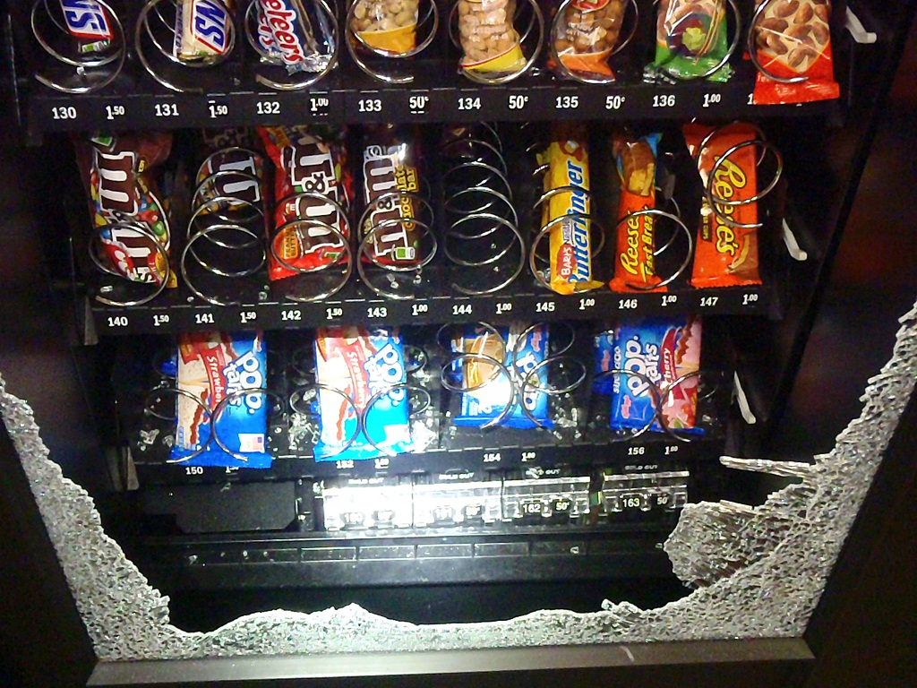A group of kids ranging in ages 6 to 16 are suspected of breaking into Dzantik'i Heeni Middle School and smashing this vending machine. (Photo courtesy of Juneau Police Department)