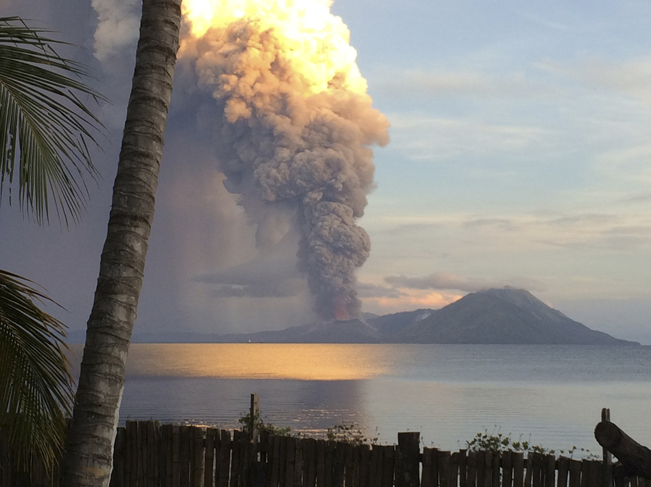 Smoke billows from Mount Tavurvur after an eruption in Kokopo, east New Britain, Papua New Guinea, on Friday. The eruption has caused some nearby residents to be evacuated and some flights to be rerouted. Jason Tassell/AP