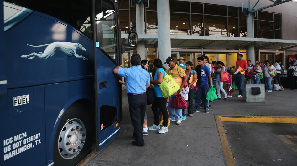 "Immigrants board a bus after being released from U.S. Border Patrol detention in Texas last month. An immigration judge says the Obama administration's ""fast-tracking"" effort means many people go into court without an attorney, opening a door to future problems. John Moore/Getty Images"
