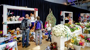 Visitors look at a memorial at Amsterdam's Schiphol Airport on Monday. ROBIN VAN LONKHUIJSEN/AFP/Getty Images