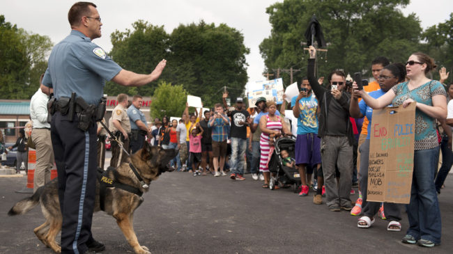 Protestors confront police during a rally to protest the shooting of Michael Brown, 18, by police in Ferguson, Mo. Brown died following a confrontation with police, according to St. Louis County Police Chief Jon Belmar. Sid Hastings/AP