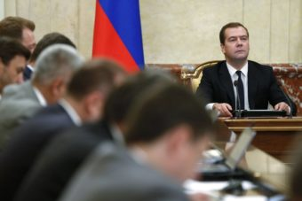 Russian Premier Dmitry Medvedev, right, heads the Cabinet meeting in Moscow on Thursday. Dmitry Astakhov/AP