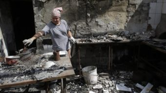 A woman removes debris from a cafe that was destroyed during fighting between Ukrainian forces and pro-Russian militants Aug. 5 in the eastern Ukrainian city of Slavyansk, in the region of Donetsk. Anatolii Stepanov/AFP/Getty Images