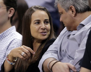 The San Antonio Stars' Becky Hammon, seen here attending a Spurs playoff game, has been hired as a full-time assistant coach, joining the NBA's reigning champions for next season. Eric Gay/AP