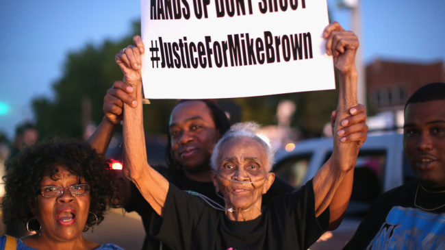 Creola McCalister, 88, protests the killing of teenager Michael Brown on Tuesday at a rally outside Greater St. Mark Family Church. Brown's death Saturday has sparked both peaceful rallies and violence this week. Scott Olson/Getty Images