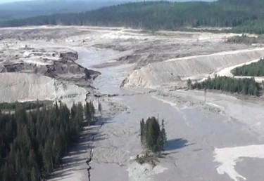 This aerial image from a British Columbia emergency office video shows the Mount Polley dam breaks and some of the damage downstream.