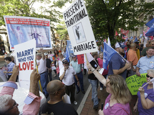 Supporters and opponents of gay marriage demonstrate outside the federal appeals court in Richmond, Va., in May. Steve Helber/AP