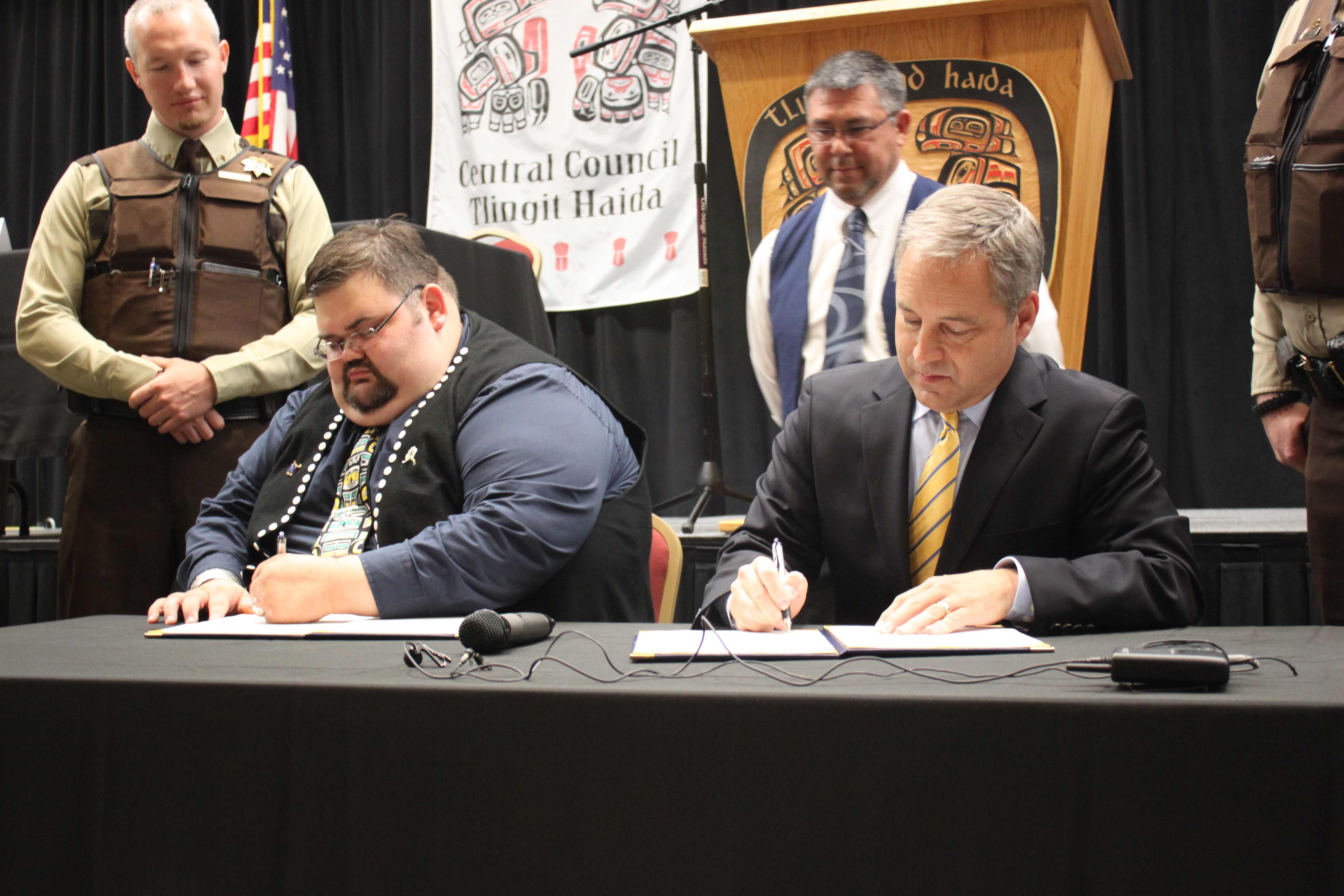 Central Council President Richard Peterson and Gov. Sean Parnell sign a Memorandum of Agreement on Monday at the Elizabeth Peratrovich Hall. (Photo by Lisa Phu/KTOO)
