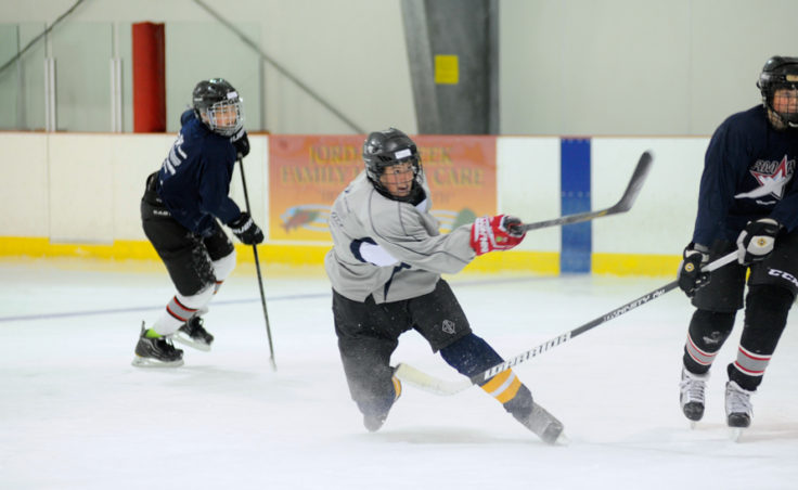 Corey Box unleashes a shot during a three-on-three Rocky Mountain Hockey School drill at Treadwell Ice Arena.