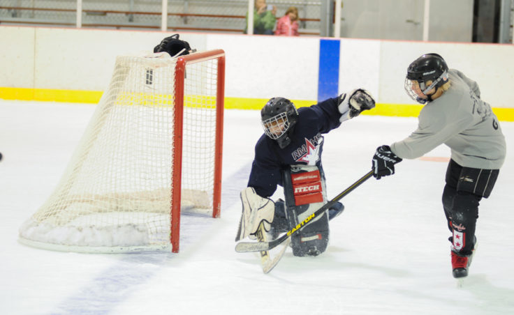 Goalie Zach Stagg turns back Paxton Wildes during a Rocky Mountain High School drill at Treadwell Ice Arena.