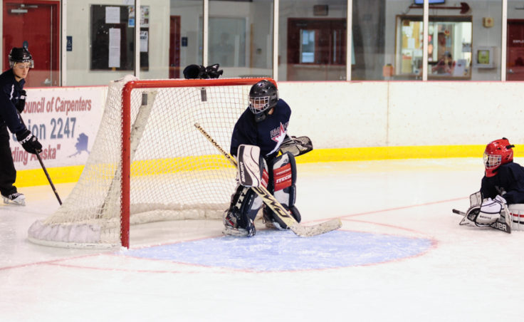 Former Juneau Douglas High School standout goalie Colter Pritchard works with goalies during a Rocky Mountain Hockey School drill at Treadwell Ice Arena.