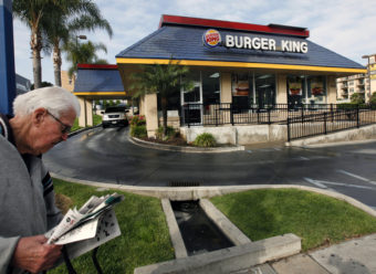 A pedestrian walks past a Burger King restaurant near downtown Los Angeles. Nick Ut/AP