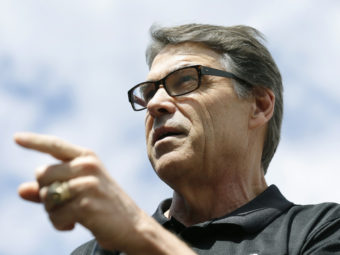 Texas Gov. Rick Perry speaks at the Des Moines Register's Political Soapbox at the Iowa State Fair on Tuesday. Late Friday, Perry was indicted on abuse-of-power charges. Charlie Neibergall/AP